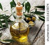 jug with extra virgin olive oil ... | Shutterstock . vector #1011615874