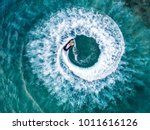 people are playing a jet ski in ... | Shutterstock . vector #1011616126