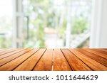 wooden board empty table in...   Shutterstock . vector #1011644629