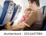 young tired father and his... | Shutterstock . vector #1011647584