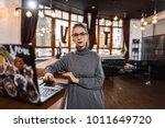 receptionist standing at... | Shutterstock . vector #1011649720