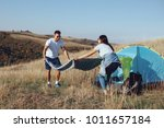 happy couple laying down picnic ... | Shutterstock . vector #1011657184