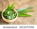fresh green pandan in a wooden... | Shutterstock . vector #1011672196