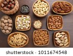 different kinds of nuts in... | Shutterstock . vector #1011674548