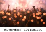 Stock photo party concert abstract blur crowd raising their hands and enjoying great festival party or concert 1011681370