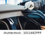 car wrapping specialist putting ... | Shutterstock . vector #1011682999