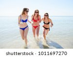 smiling young girls on the... | Shutterstock . vector #1011697270