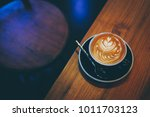 barista make coffee latte art... | Shutterstock . vector #1011703123