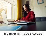pensive squinting young student ... | Shutterstock . vector #1011719218