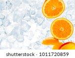 juicy oranges on ice cubes ... | Shutterstock . vector #1011720859