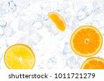 juicy oranges on ice cubes... | Shutterstock . vector #1011721279