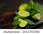 lime and peppermint on the... | Shutterstock . vector #1011731500