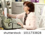 typist. woman sitting at the... | Shutterstock . vector #1011733828