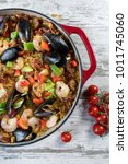 Small photo of Mediterranean Paella in cast iron dish top view
