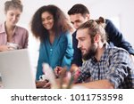 young multiethnic business team ... | Shutterstock . vector #1011753598