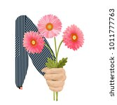 a man s hand gives a bouquet... | Shutterstock .eps vector #1011777763