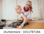 doctor woman examining... | Shutterstock . vector #1011787186