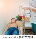 doctor with electrocardiogram...   Shutterstock . vector #1011787234