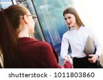 two girls managers smile and... | Shutterstock . vector #1011803860