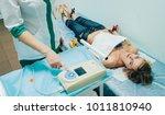 doctor with electrocardiogram...   Shutterstock . vector #1011810940