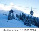 cabin ski lift over a ski piste | Shutterstock . vector #1011816244