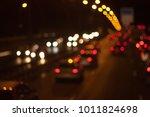 suburbian road in the evening ... | Shutterstock . vector #1011824698
