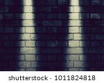 fragment of a brick wall with... | Shutterstock . vector #1011824818