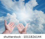 hands reaching for the sky | Shutterstock . vector #1011826144