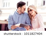 young couple looking at a... | Shutterstock . vector #1011827404