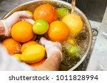 Chef Washing Mix Of Citrus...
