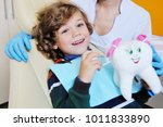 a small boy with curly hair in...   Shutterstock . vector #1011833890