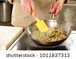 cooking vegetables in pan using ... | Shutterstock . vector #1011837313