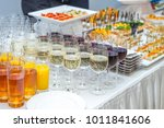 catering table with alcoholic... | Shutterstock . vector #1011841606