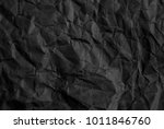 black crumpled paper texture or ... | Shutterstock . vector #1011846760