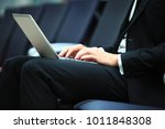 young adult businessman using... | Shutterstock . vector #1011848308