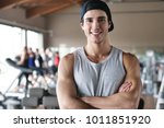 portrait of a boy in a gym that ... | Shutterstock . vector #1011851920