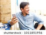 portrait of smiling middle aged ... | Shutterstock . vector #1011851956