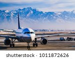 Beautiful view of the snow covered mountains from Salt Lake City whilst in the airport lounge getting ready for departure during winter.   - stock photo