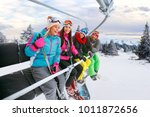 cheerful young friends on ski... | Shutterstock . vector #1011872656