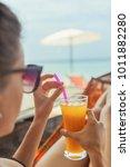 woman on hammock on tropical... | Shutterstock . vector #1011882280