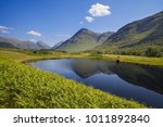 glencoe lochan area of forest... | Shutterstock . vector #1011892840