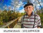 elderly 80 plus year old man... | Shutterstock . vector #1011894328