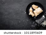 parmesan cheese on black... | Shutterstock . vector #1011895609