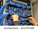 Man Connecting Network Cables...