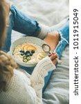 healthy winter breakfast in bed.... | Shutterstock . vector #1011915049
