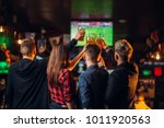 Stock photo friends watches football on tv in a sport bar 1011920563