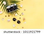 traveler accessories on yellow... | Shutterstock . vector #1011921799