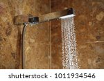 hot shower with water stream | Shutterstock . vector #1011934546