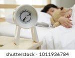 child girl sleeping with alarm...   Shutterstock . vector #1011936784