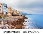 restaurant at rocky coast of... | Shutterstock . vector #1011939973